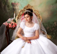 girl communion portrait in Long Island studio with roses and candle