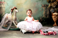 baby toddler girl in fancy pink dress and pearls with toy pony on Long Island