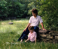 brothers sitting at stone wall portrait on Long Island