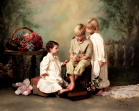 young siblings in vintage clothing looking at music box