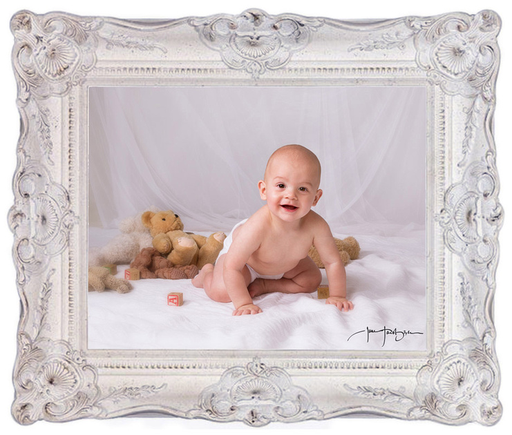 smiling baby portrait in white frame